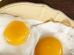 Plate with two eggs served sunny side up