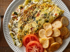 Garden omelet served with tomatoes and home fries