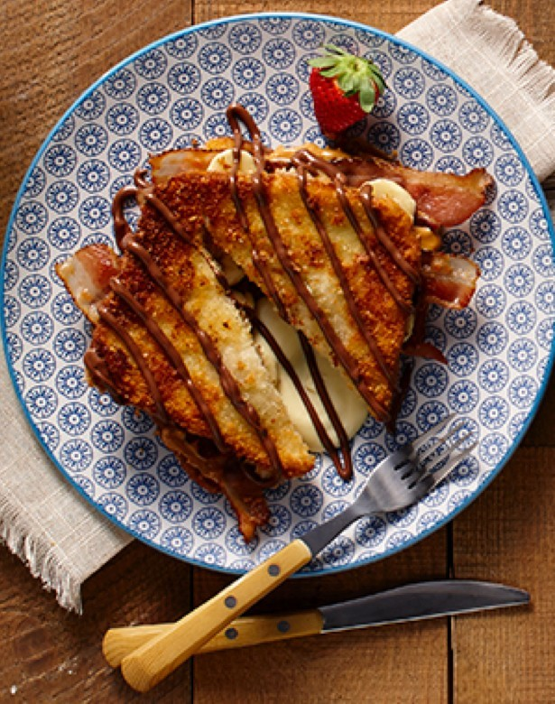Crispy french toast sandwich with bacon, chocolate and custard